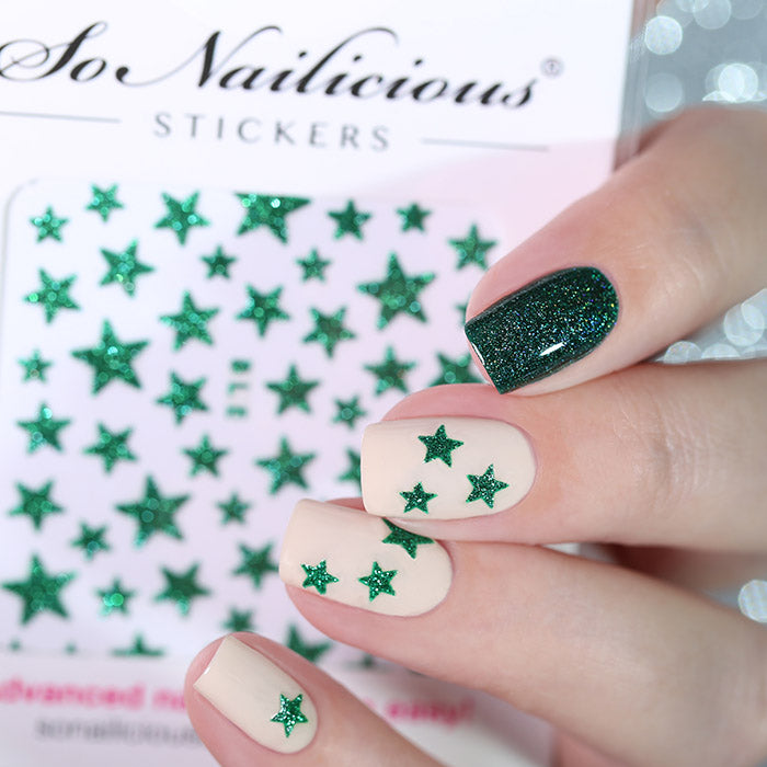 Green nails with green glitter star stickers