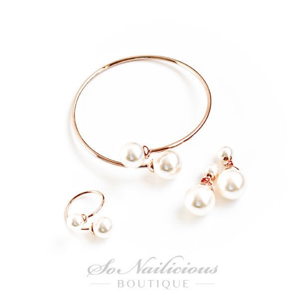 Pearl earrings, pearl bracelet and pearl rings