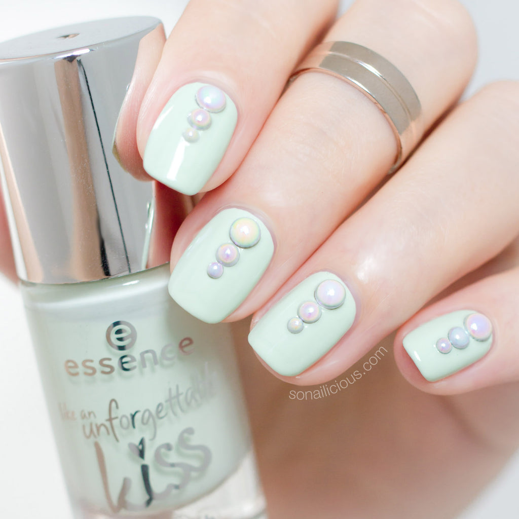 Mint nails with Unicorn studs