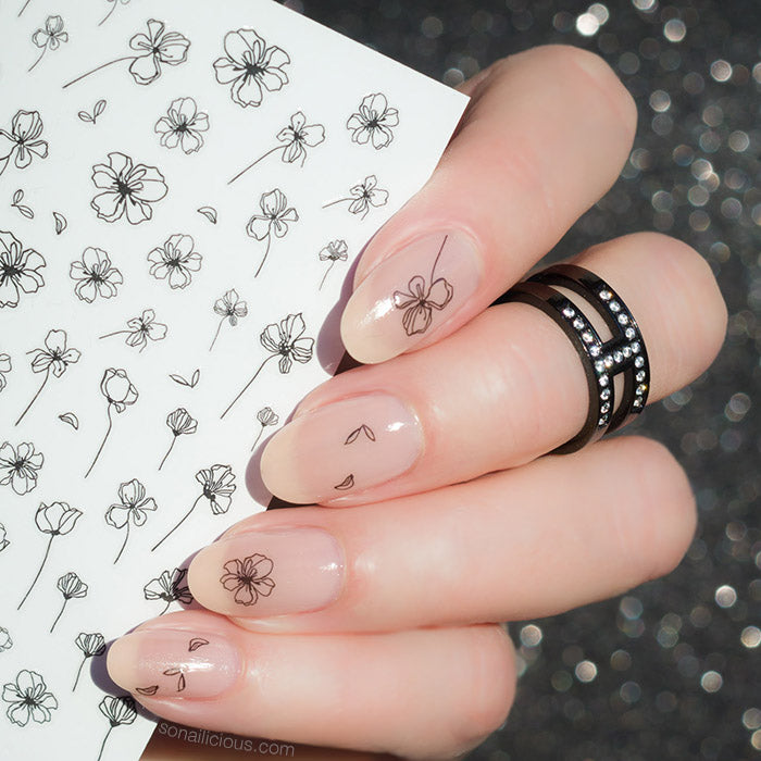 nude nails with black flower tatto stickers