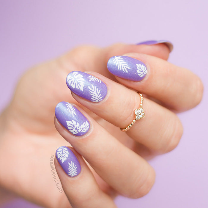 purple tropical nails with palm leaf stickers