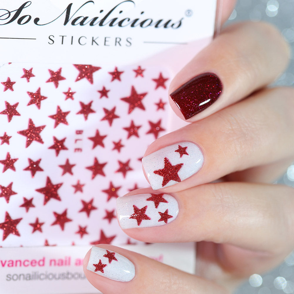 White nails with red glitter star stickers