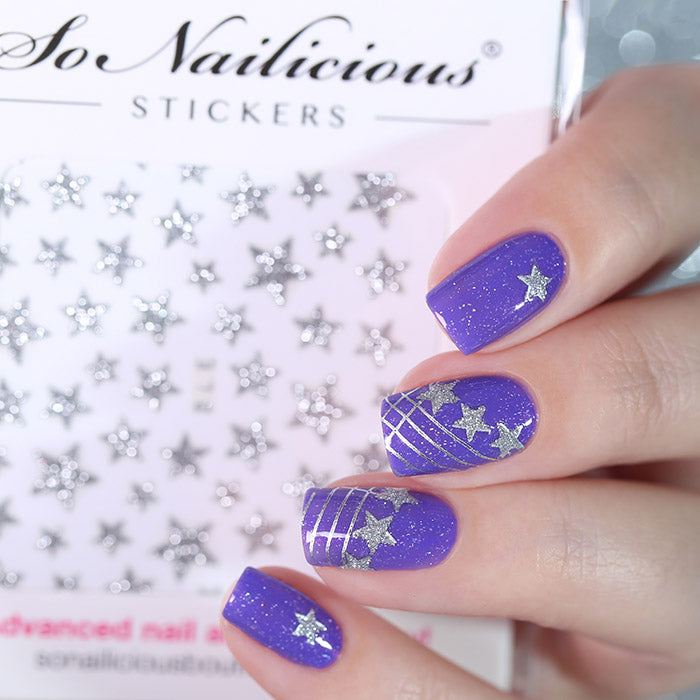 Purple nails with silver glitter star stickers