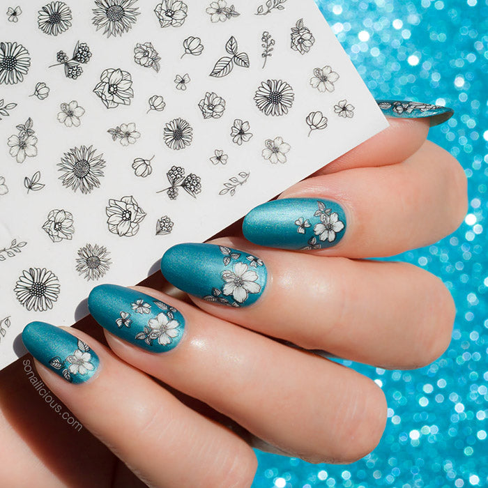 white and blue nails with sonailicious floral nail stickers