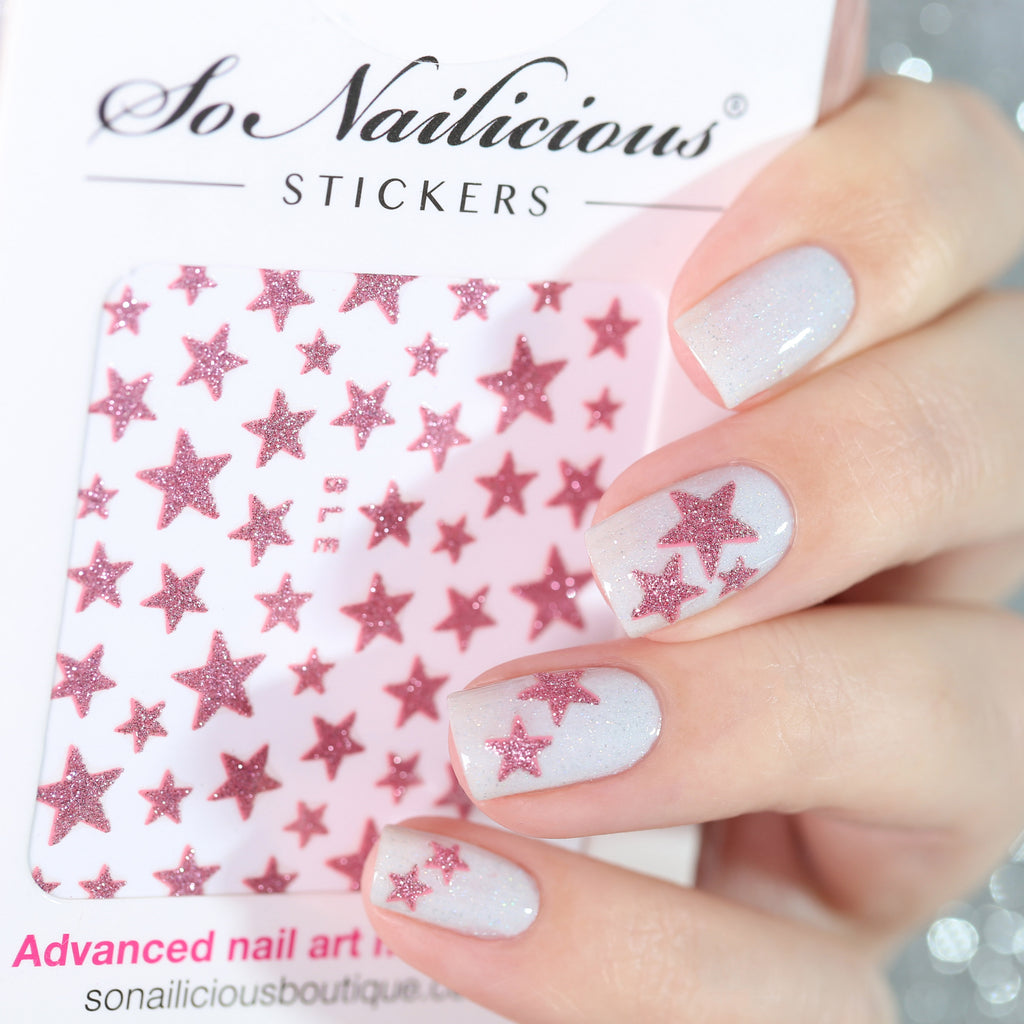 White nails with pink glitter star stickers