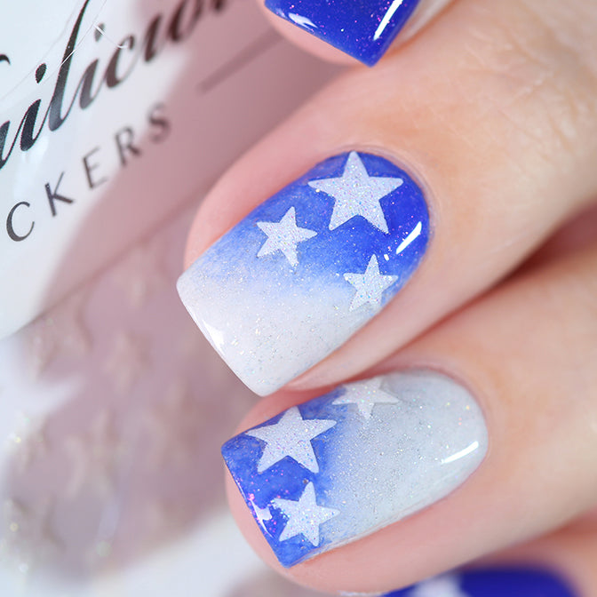 Blue nails with white glitter star stickers