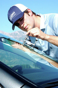 male technician repairing a windshield
