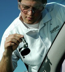 male technician using windshield repair bridge