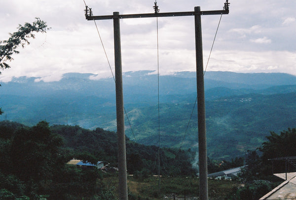 The endless view of tea mountains, through power-poles, in Yunnan