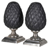 Pair Of Black Oval Decorations On Stands