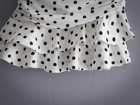 layered hem of a short polka dot skirt