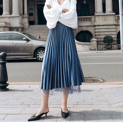 model wearing a velvet blue skirt