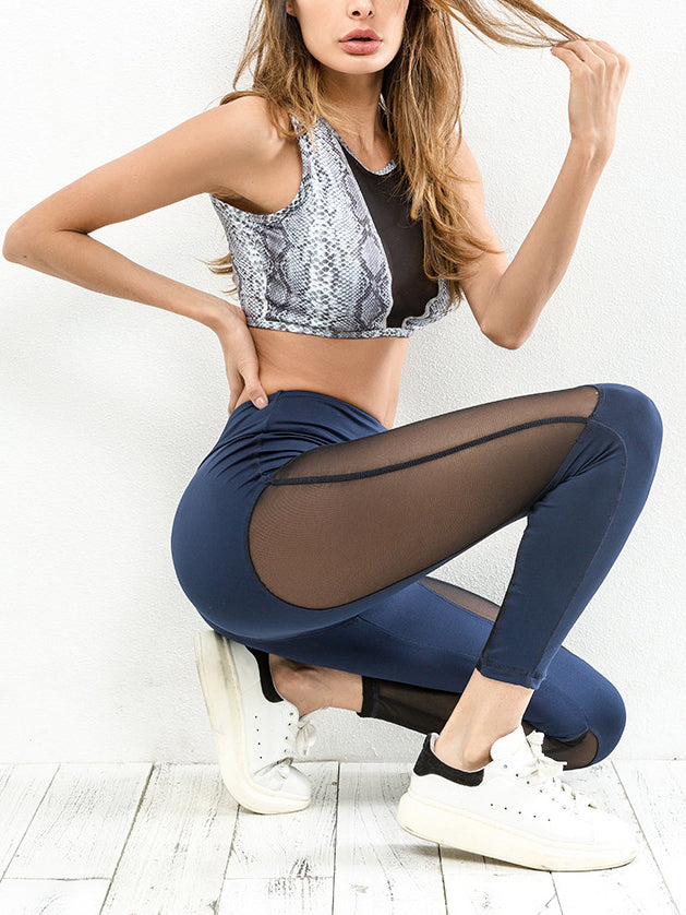 This high rise sports legging features a next-to-skin fit and mesh inserts for breathability