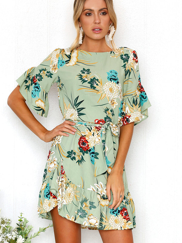 Effortless and beautiful, this floarl printed mini dress features a boat neckline and short flared sleeves.