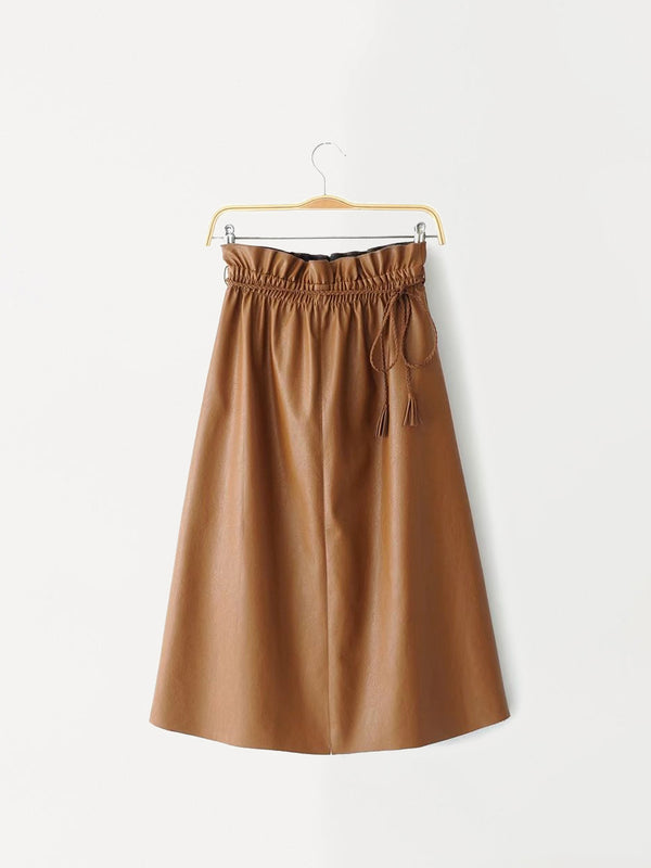 Easily dressed up or down, this leather midi skirt features an elastic waist with pleat details and a braided strap.