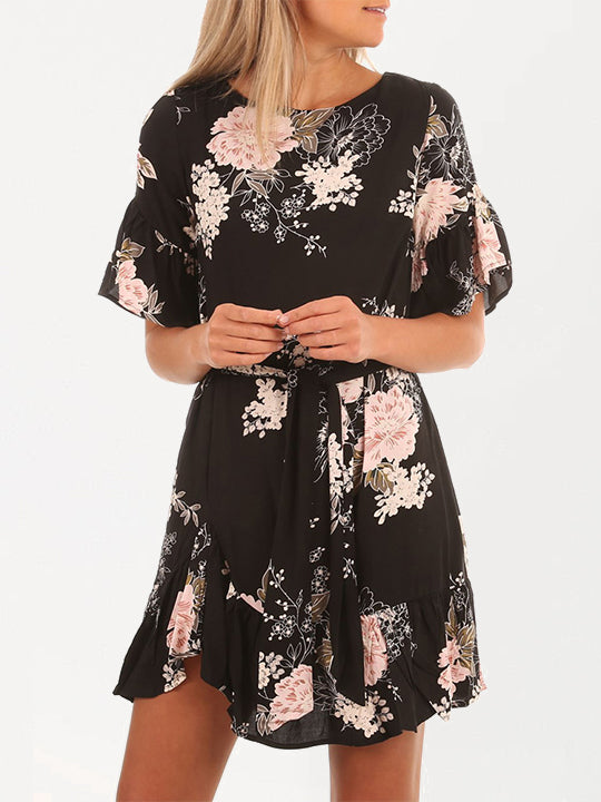 Vintage-inspired wrap dress features an allover floral print and bell-shaped sleeve cuffs