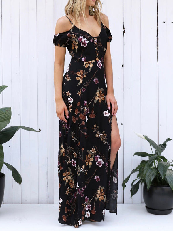 Gorgeous floral maxi dress featuring delicate cold shoulder style with elastic short sleeves and a crossed, strappy front design along the V neckline