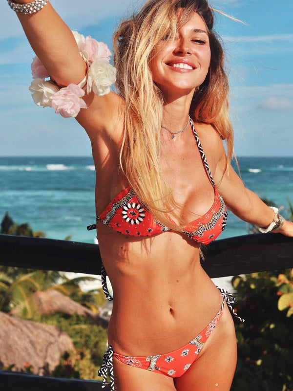 Triangle bikini top featured in paisley print with floral trimming and a halter neckline with zigzag details