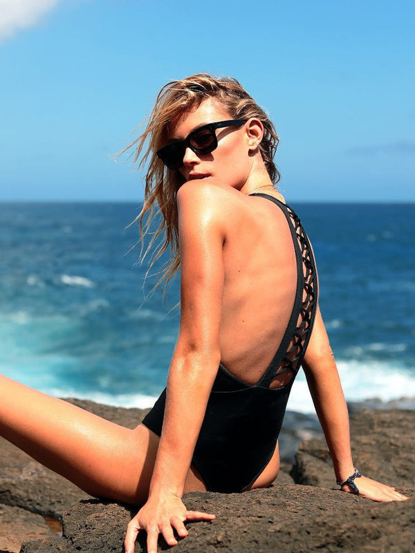 Solid one-piece bikini featuring a scoop neckline and a strappy low-back