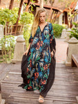 Boho-inspired maxi dress featured in a slouchy silhouette and exaggerated batwing sleeves