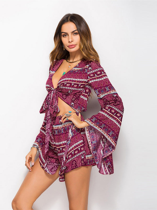 Boho printed romper featured in a front lace-up design and a slouchy fit