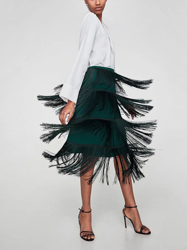 Bold midi skirt featuring an allover exaggerated tassel trimming