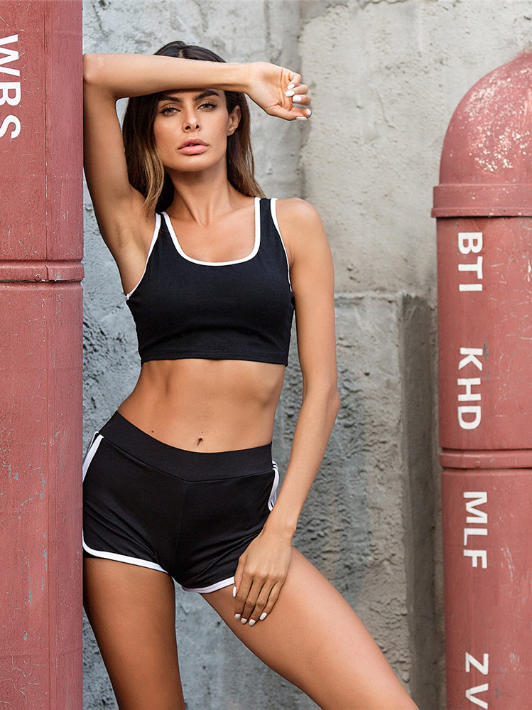 Easy pull-on sports crop featured in a scoop neckline and striped trimming