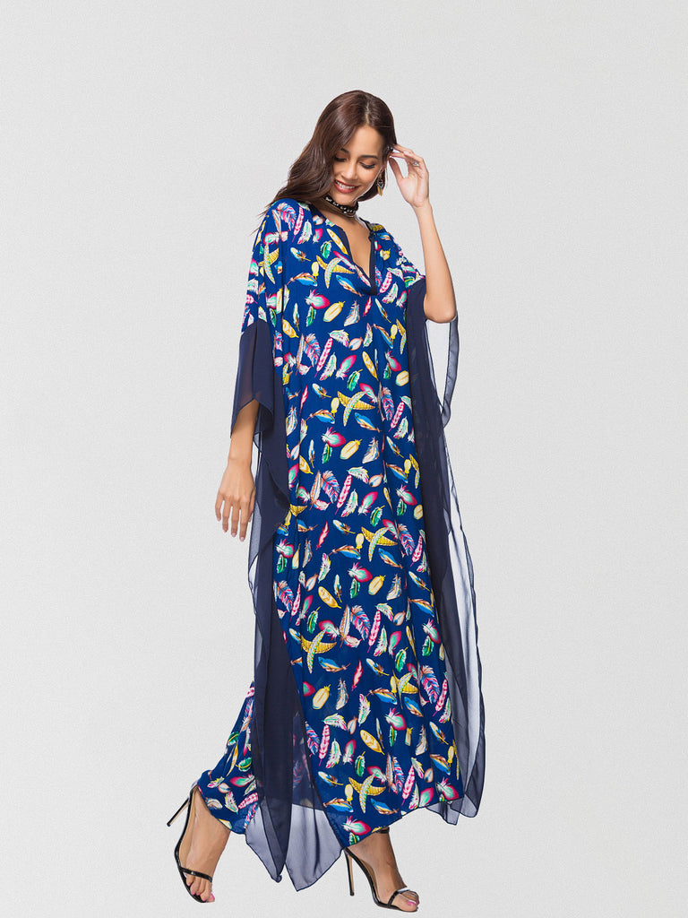 Femme printed maxi dress featured in a slouchy silhouette and exaggerated batwing sleeves