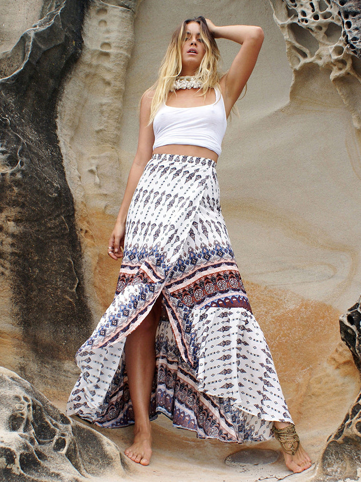 Femme printed maxi skirt featured in a front high slit design and pleat details
