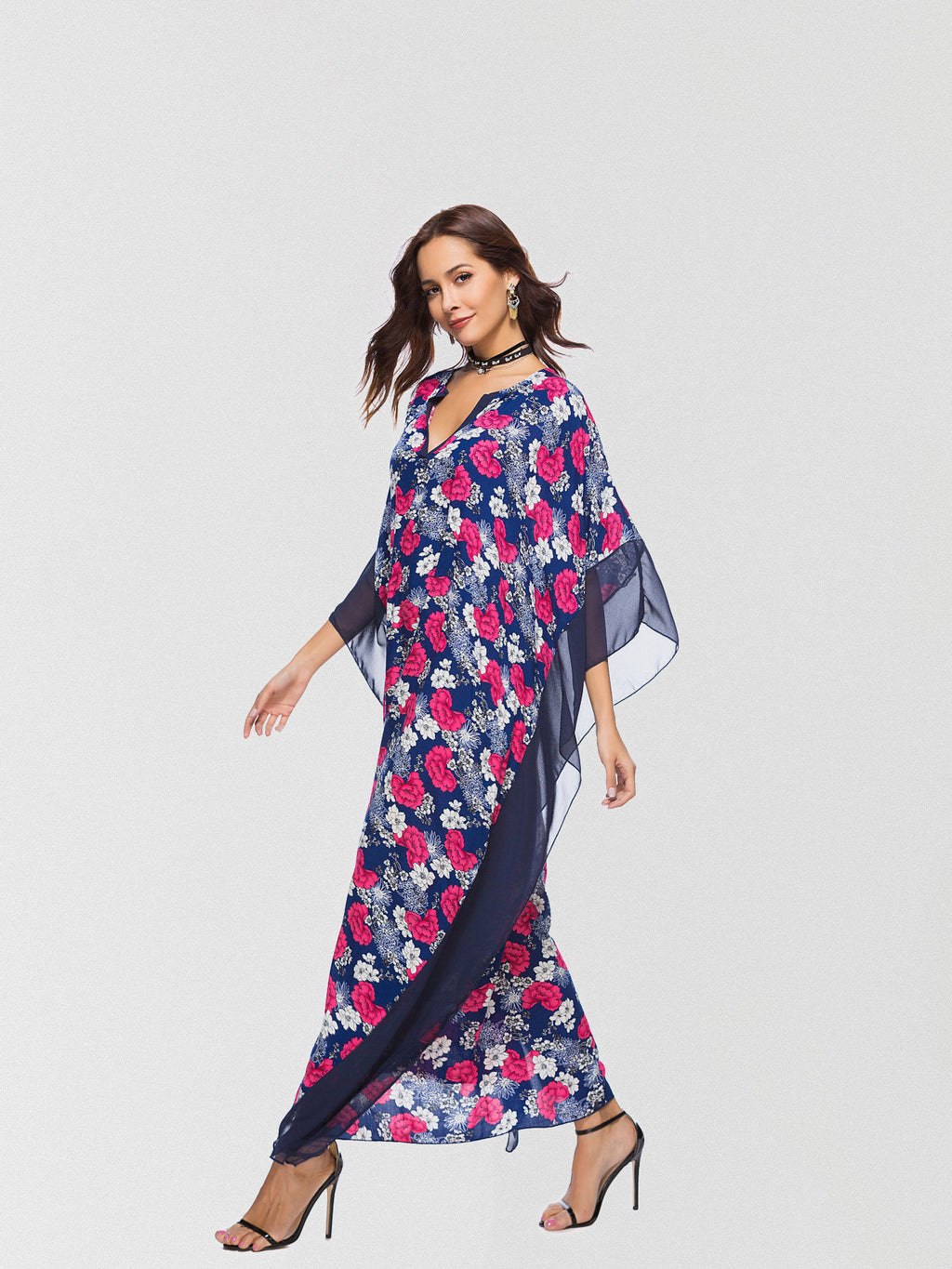 Floral printed maxi dress featured in a slouchy silhouette and exaggerated batwing sleeves