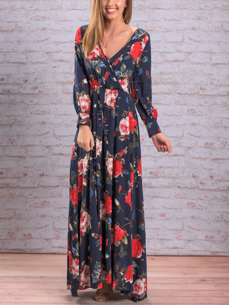 Floral printed maxi dress featured in a surplice plunging neckline and pleat details
