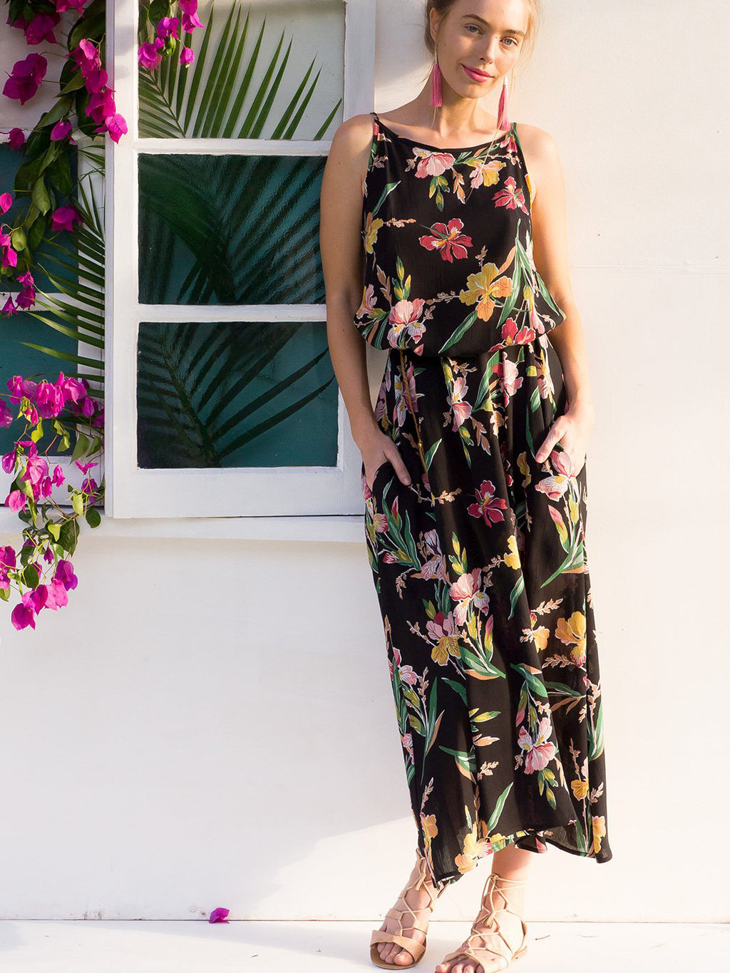 Floral printed midi dress featured in a flowy silhouette with an adjustable braided strap at the waist