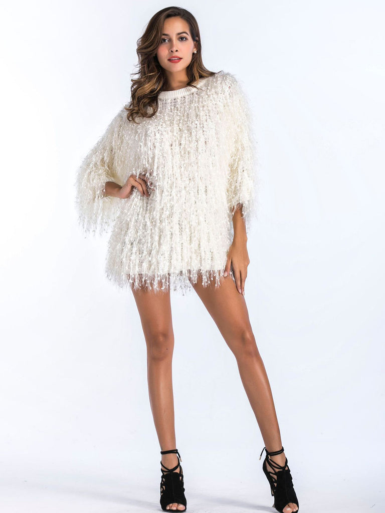 In a so cozy wool-blend, this handcrafted slouchy sweater features statement fringe detailing.