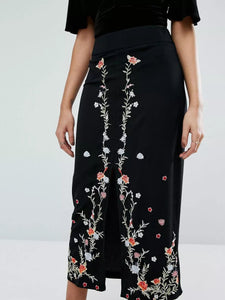 High rise midi dress featured in floral embroideries and a slitted front