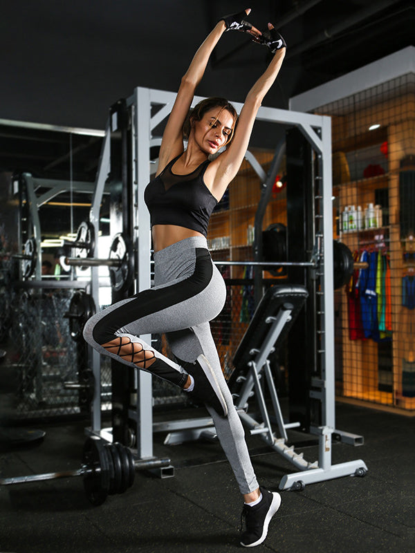 High rise sports leggings featured in striped trimming and strappy details at the leg