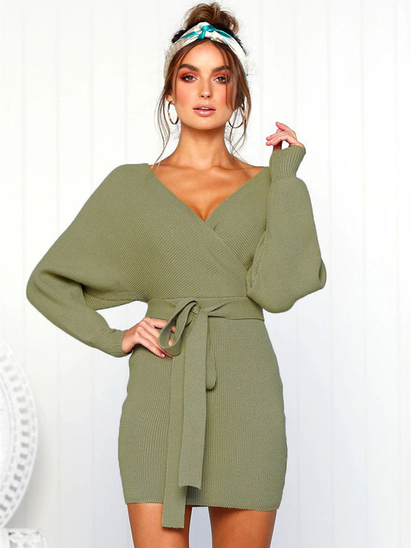 A model wearing a surplice sweater dress in an olive green color