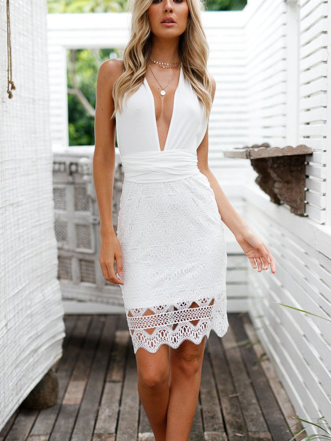 Little white dress featured in a deep plunging neckline and an open back
