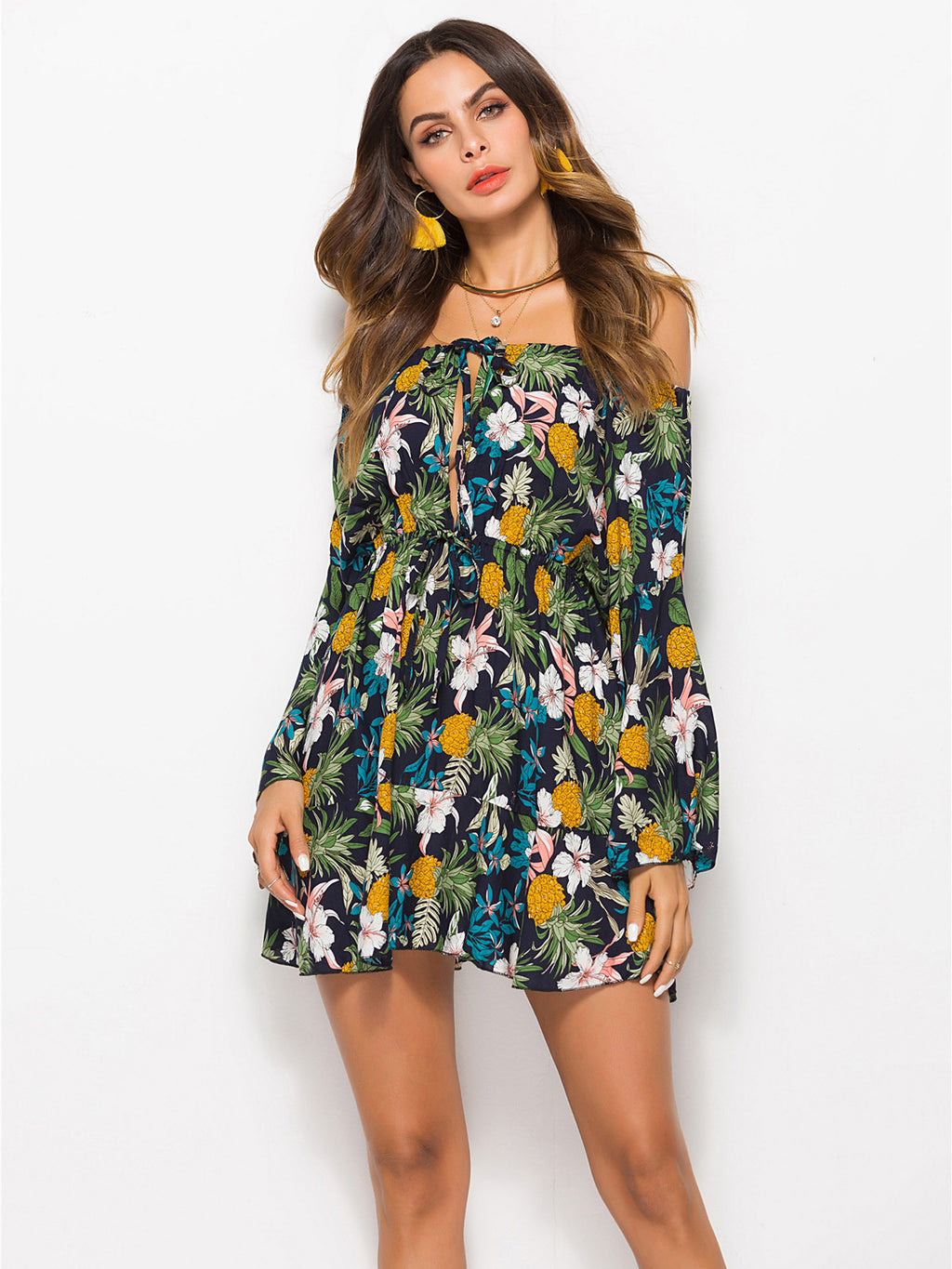 Off-the-shoulder mini dress featured in a fun pineapple print and an oversized fit