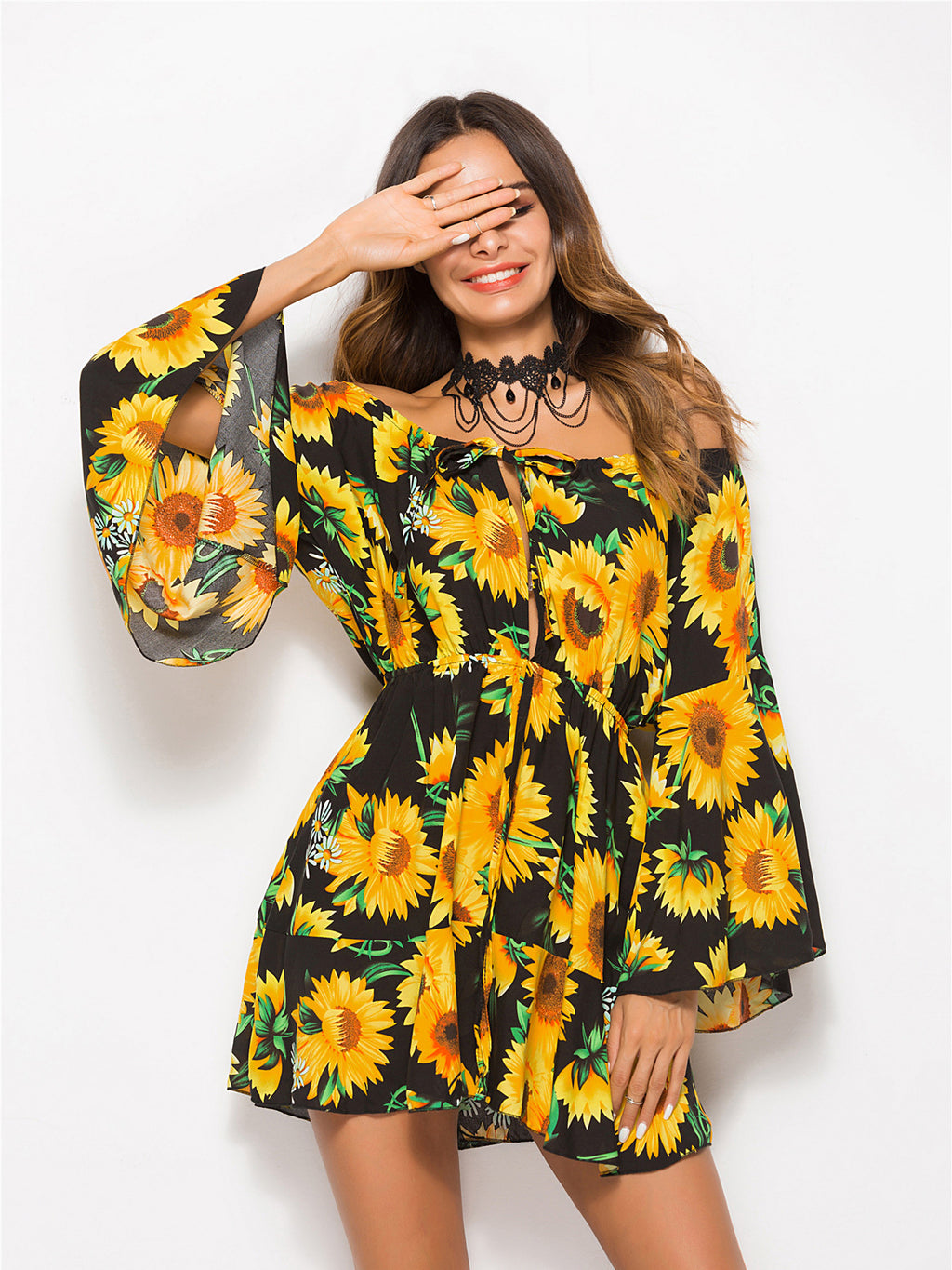 Off-the-shoulder mini dress featured in an allover sunflower print and an oversized fit