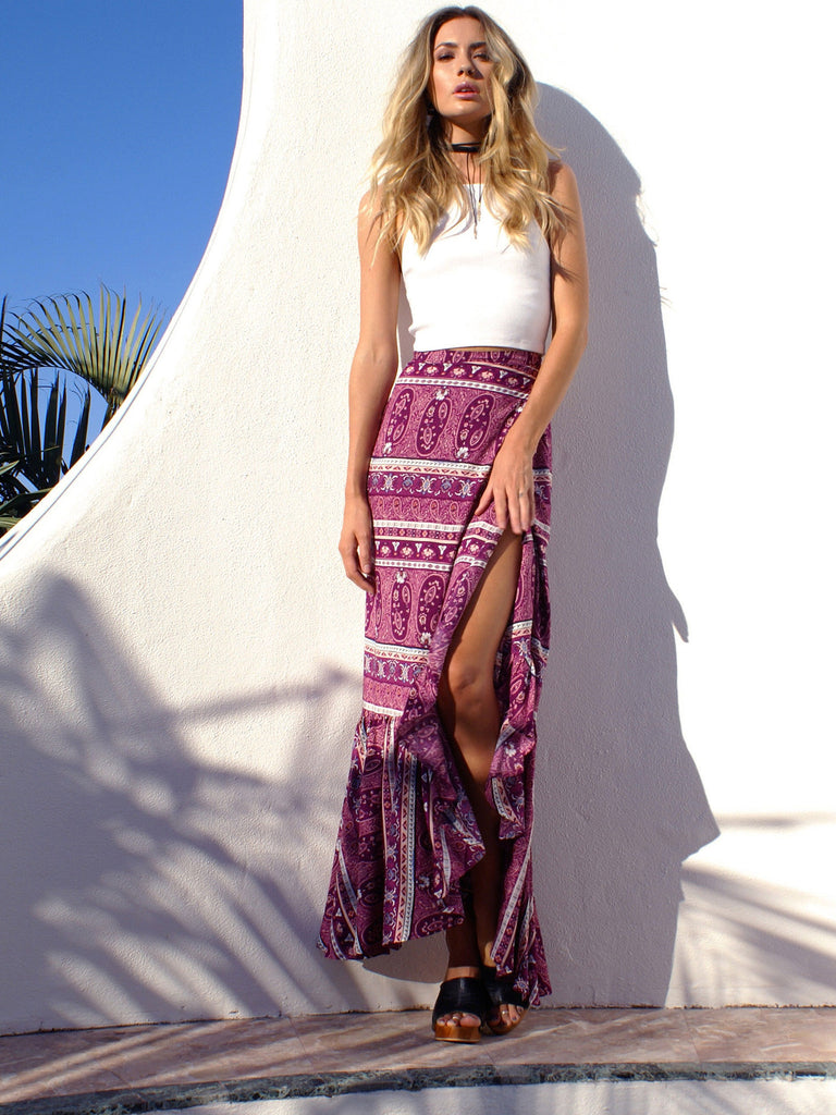 Paisley printed maxi skirt featured in a front high slit design and pleat details