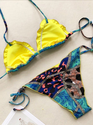 Printed bikini top featured in a triangle shape and ruffled trimming
