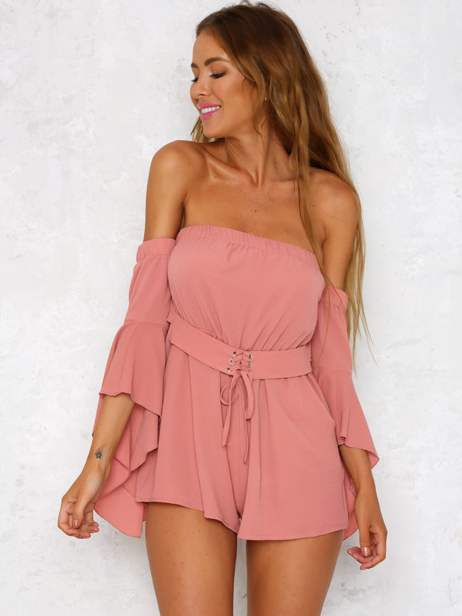 c5ed5e684dd Solid off-the-shoulder romper featuring an elastic neckline and a waistband  with lace