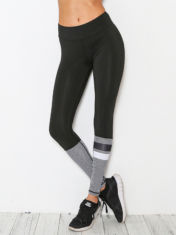 This compressive legging featured in a color block design with polka dot prints and striped details