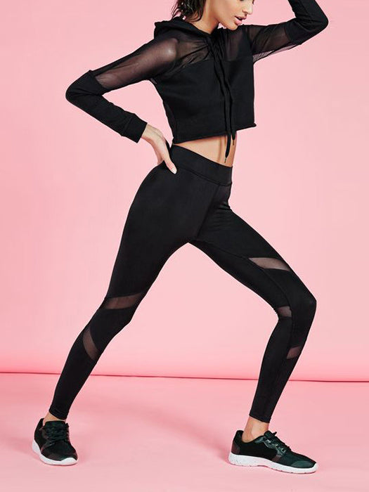 This solid legging with added mesh panels for breathability and an added fashion element.