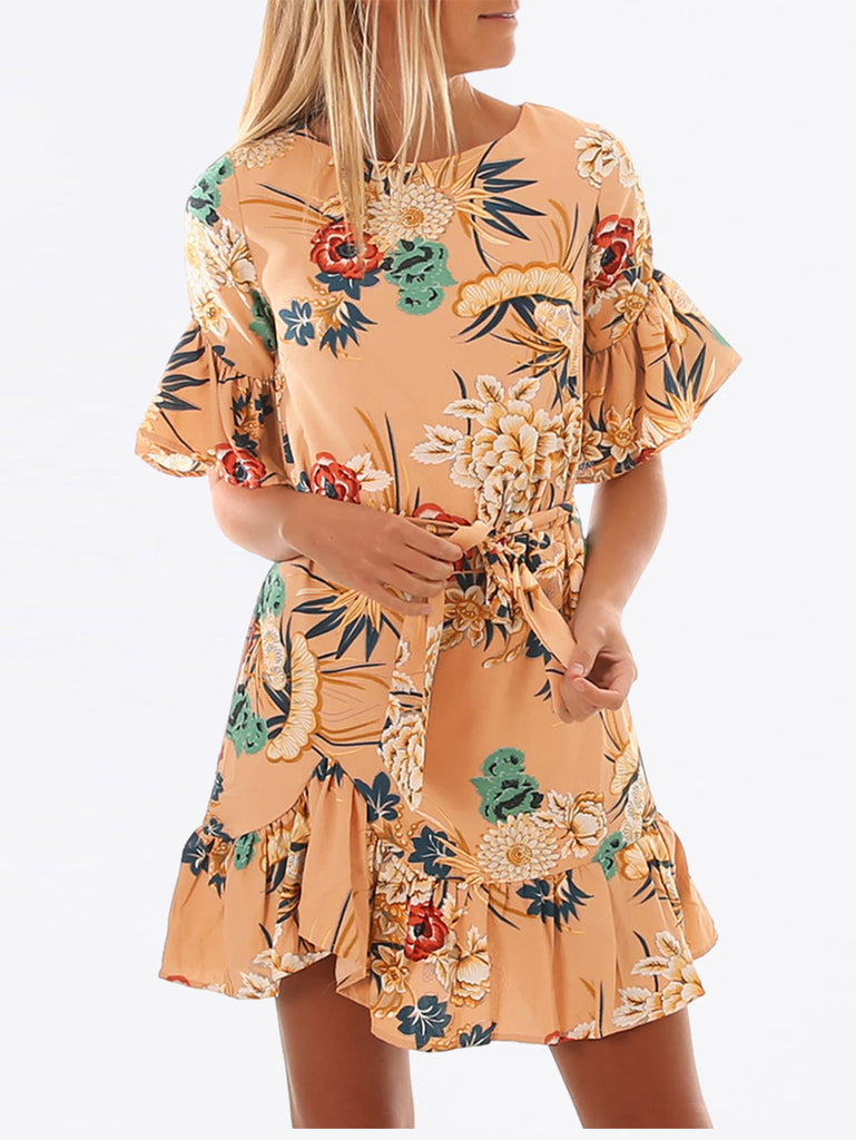 Vintage-inspired wrap dress features an allover floral print and bell-shaped sleeve cuffs and a ruffled hemline