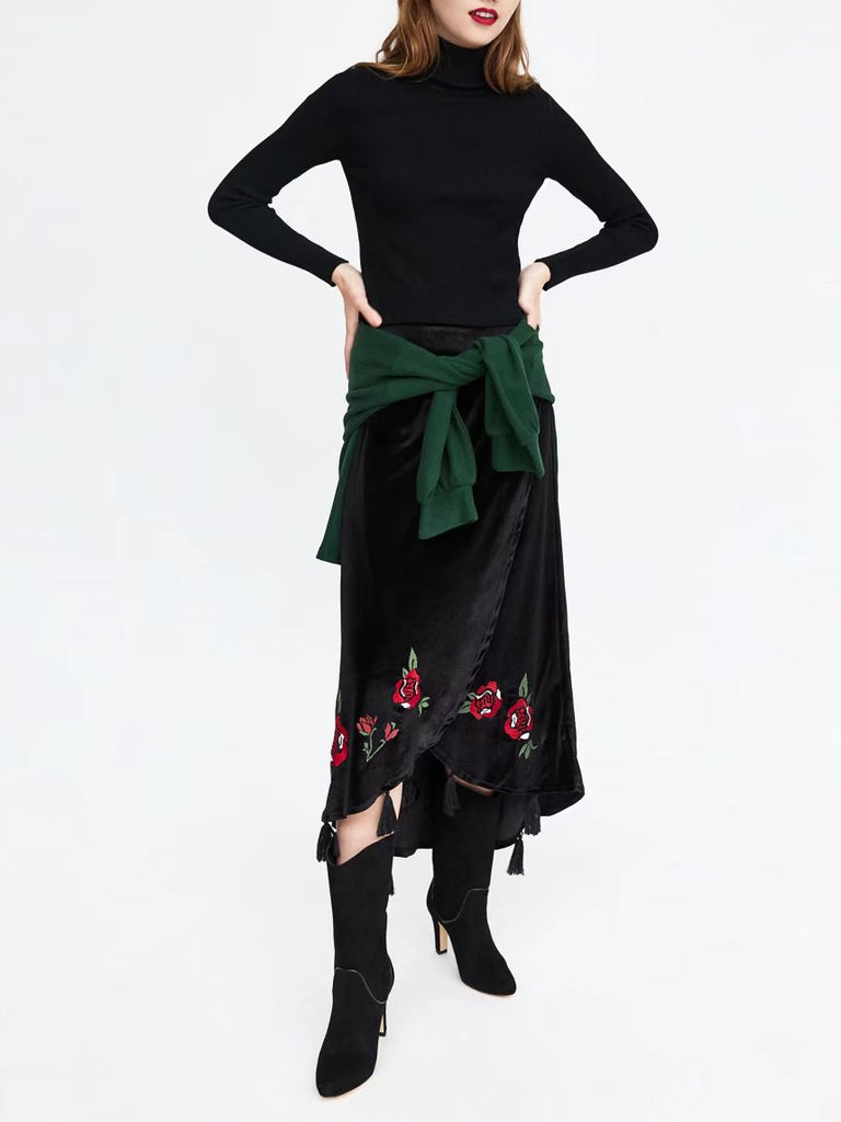 With a romantic look and a luxe velvet fabrication, this midi skirt features a surplice front and floral embroideries.