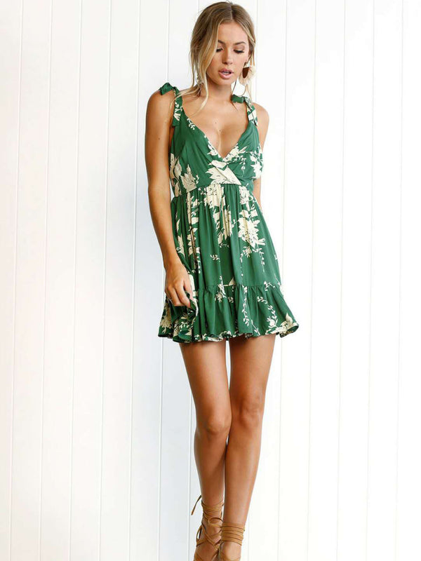 With an easy, swingy shape, this floral mini dress features a surplice plunging neckline and an open back.
