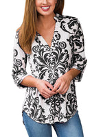 floral print plunging neck top roll-tab sleeve blouse with an asymmetriacl hemline