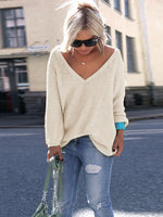 white grey pink beige long sleeve oversize pullover plunging neck loose fit sweater in a slouchy silhouette