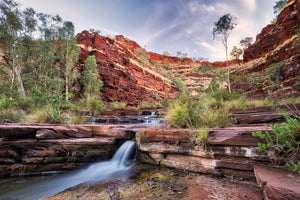 Stunning image of waterfall and rock formations at Kalamina Gorge in Karijini National Park